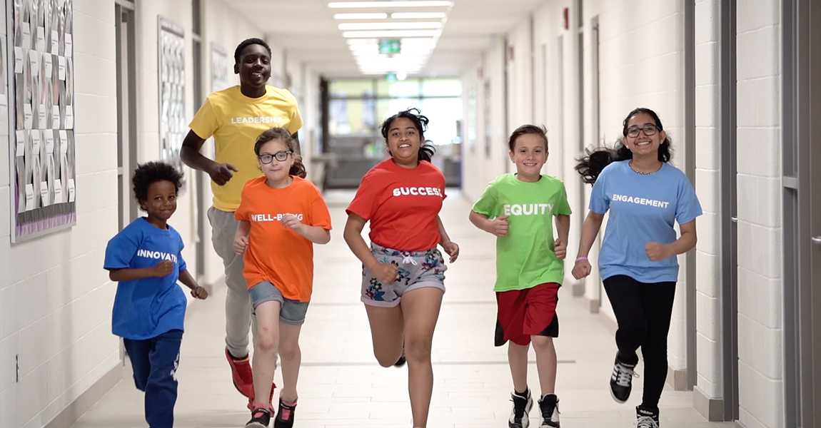 Students running down school hallway